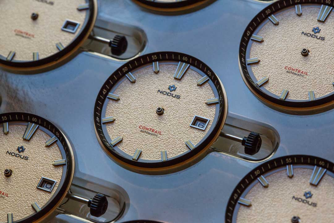 Dials are affixed onto the movement before hand installation takes place.