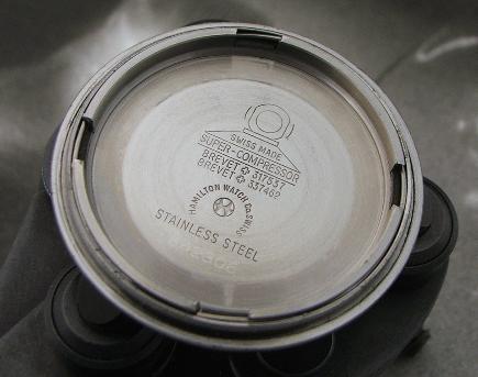 The inside of a vintage Hamilton Super Compressor caseback. Photo credit:  scubawatch.org