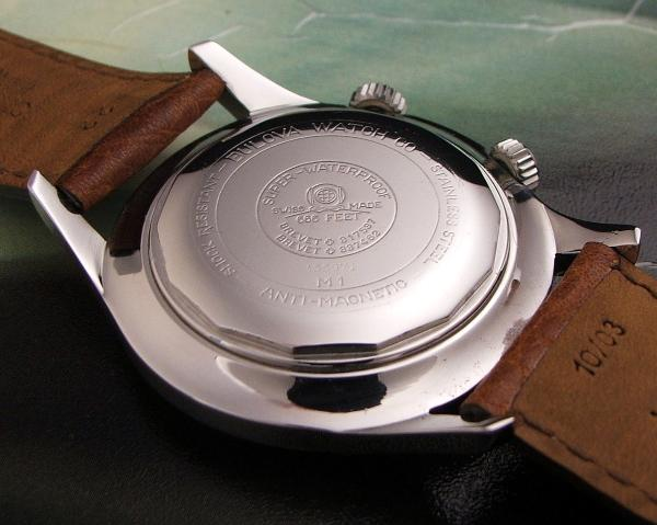 A vintage Bulova caseback with the depiction of a dive helmet Photo credit:  scubawatch.org