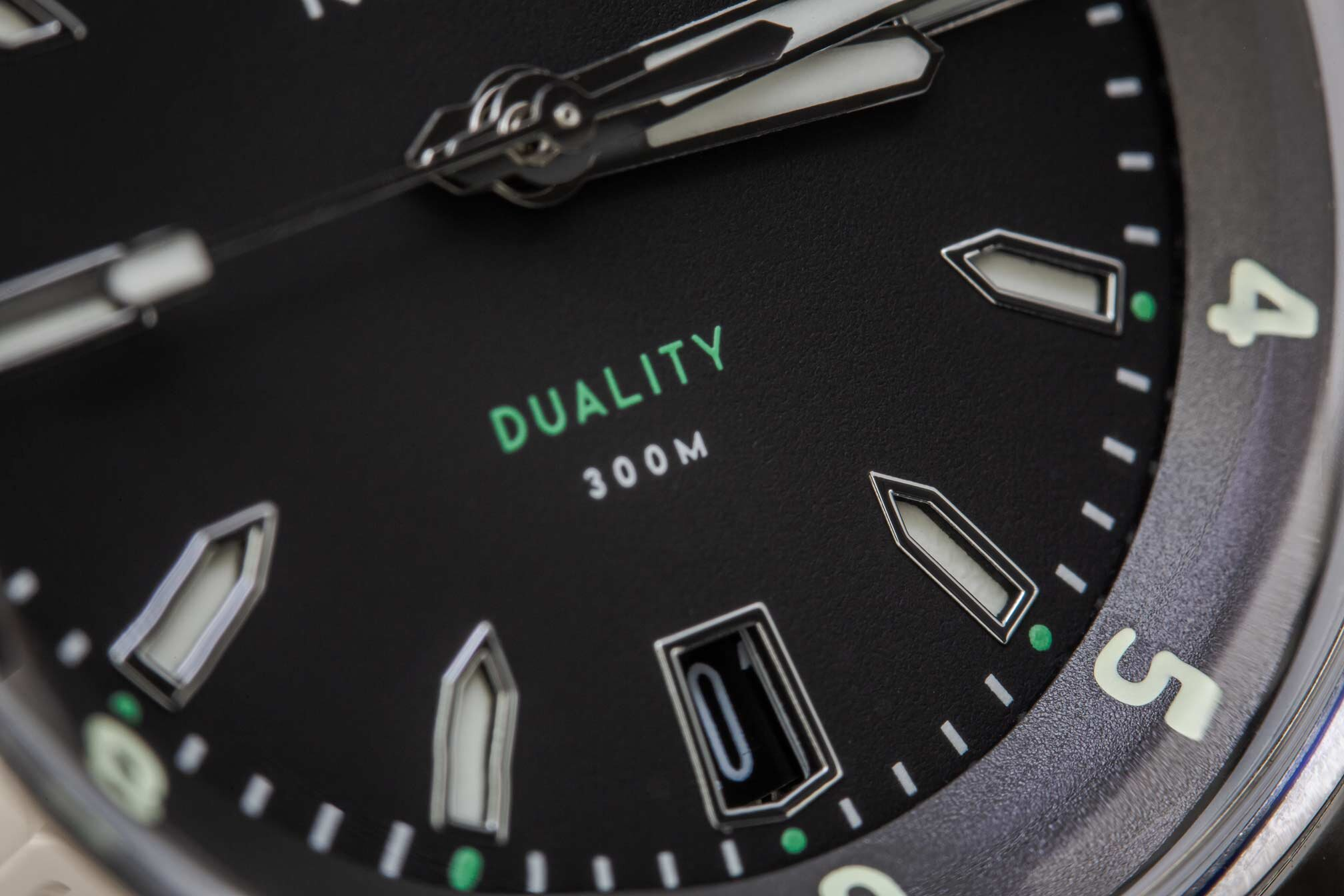 The hybrid dial - a construction that benefits from the night time visibility of a sandwich dial and daytime visibility of an applied dial.