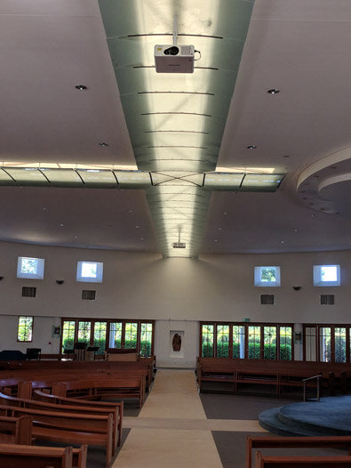 Holy cross catholic church - kippa ring - qld - 2 x panasonic dlp laser projectors projecting onto side walls of a round building - crestron hdmi switching