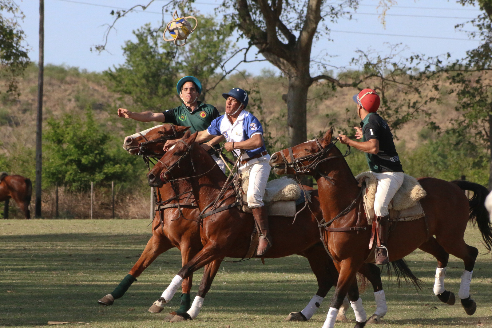 Two four-member teams fight for possession of a ball which has 6 leather handles.