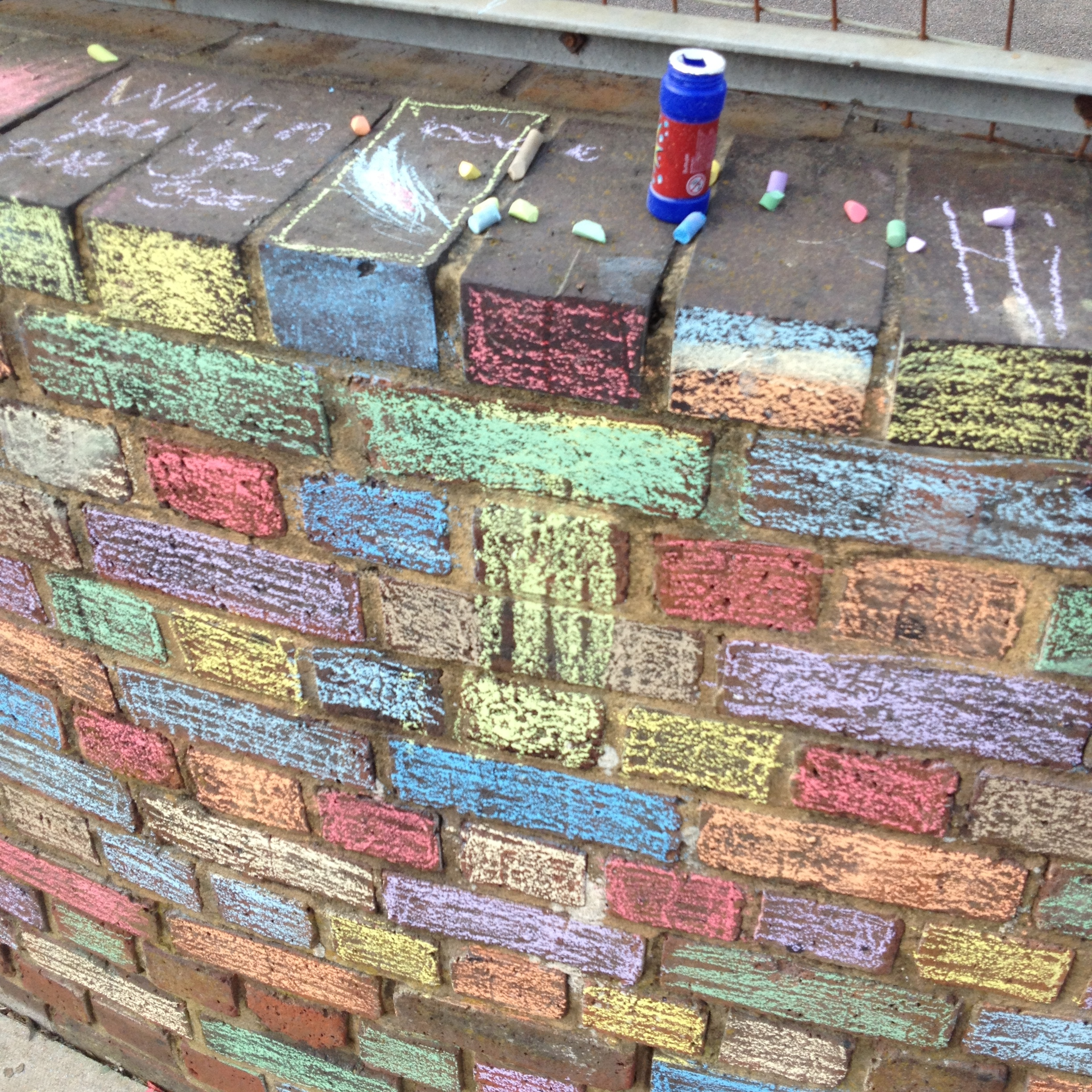 chalking the football cage wall to brighten up the neighbourhood