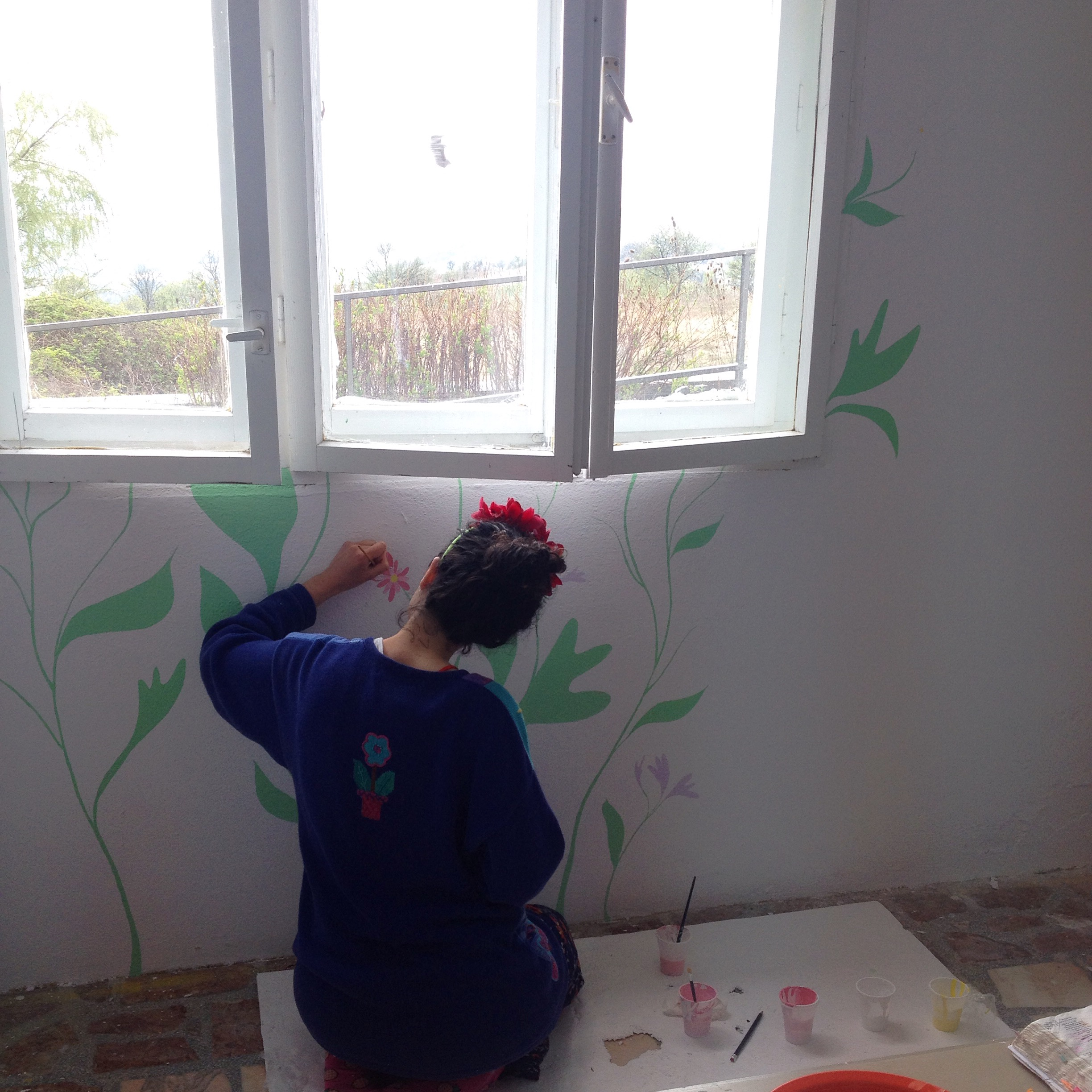 painting a garden mural in the prayer room at a retreat centre for disabled young people in Romania.