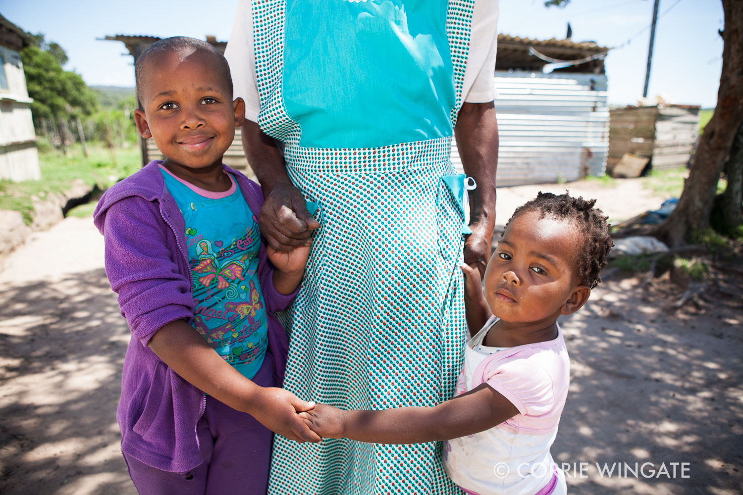 An gogo-getter who takes care of her grandchildren. Sisonke project, South Africa