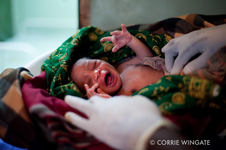 Weighing newborn, Namasalima health centre, Mulanje district, Malawi, Africa