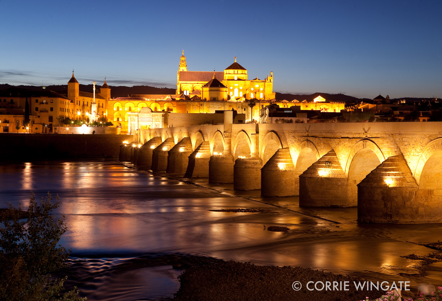 Dusk over the river Guadalquivir and Puente Romano, Cordoba, Andalucia, Spain