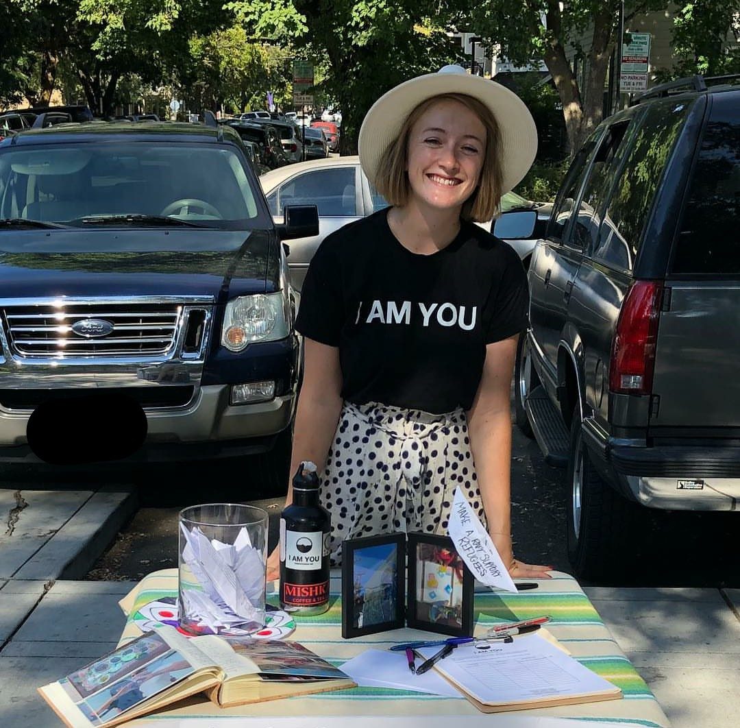 Fundraising Volunteer Astrid sets up an advocacy table at her local farmers market in Davis, California to spread the mission, share her volunteer experiences, and sign people up for our Monthly Action Mailer!