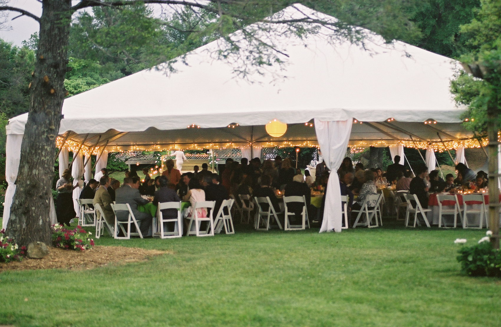 wedding reception outside under tent