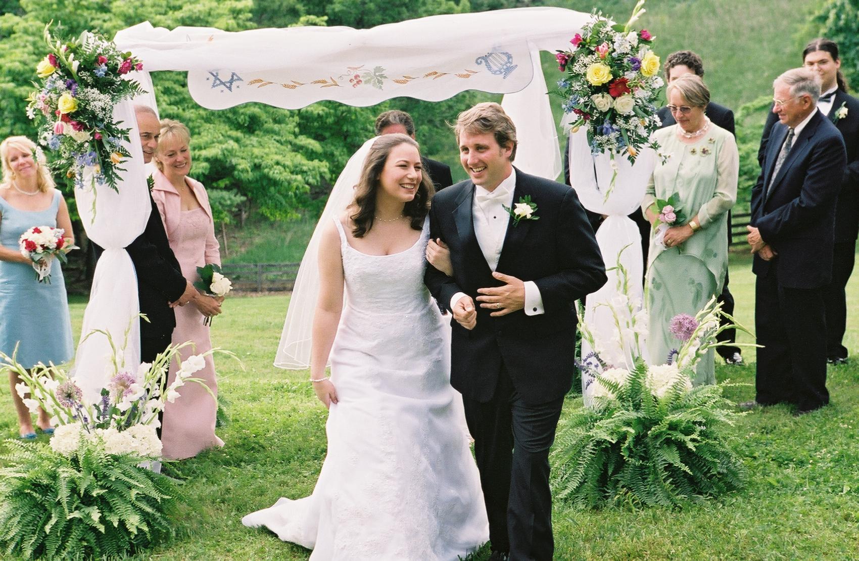 bride and groom outdoors walking