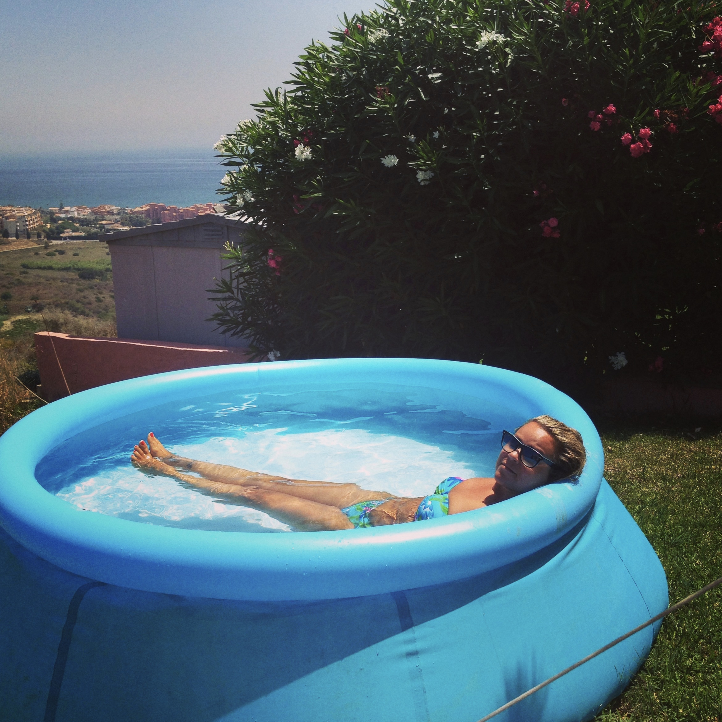A perfect example of enjoying the moment....paddling pool and a fab view *BIG SIGH*