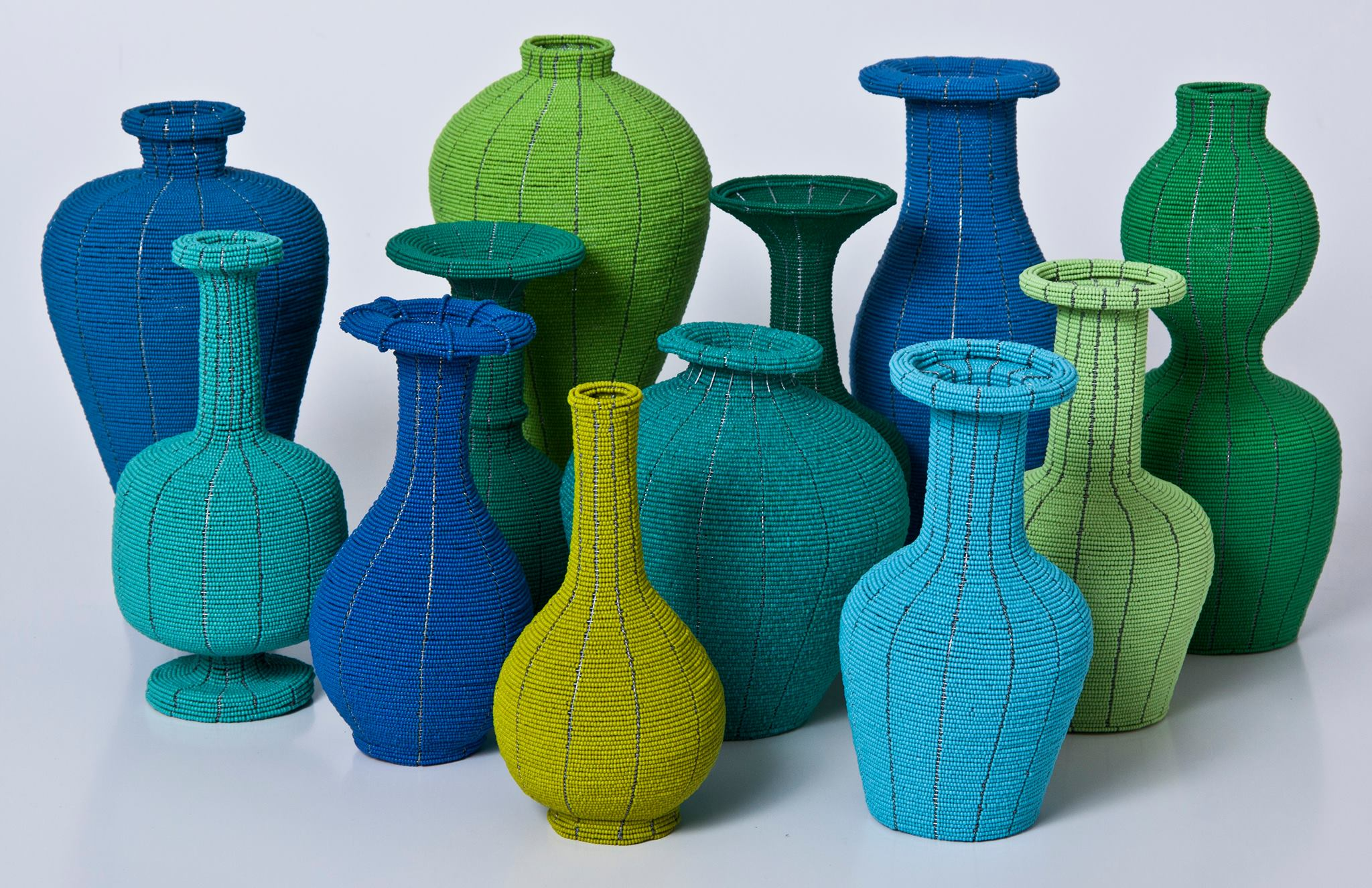Beaded Chinese Vases   These 'vases' are hand-made from tiny, Czechoslovakian glass beads in an assortment of vivid colours and Chinese vase forms.    R1200 each