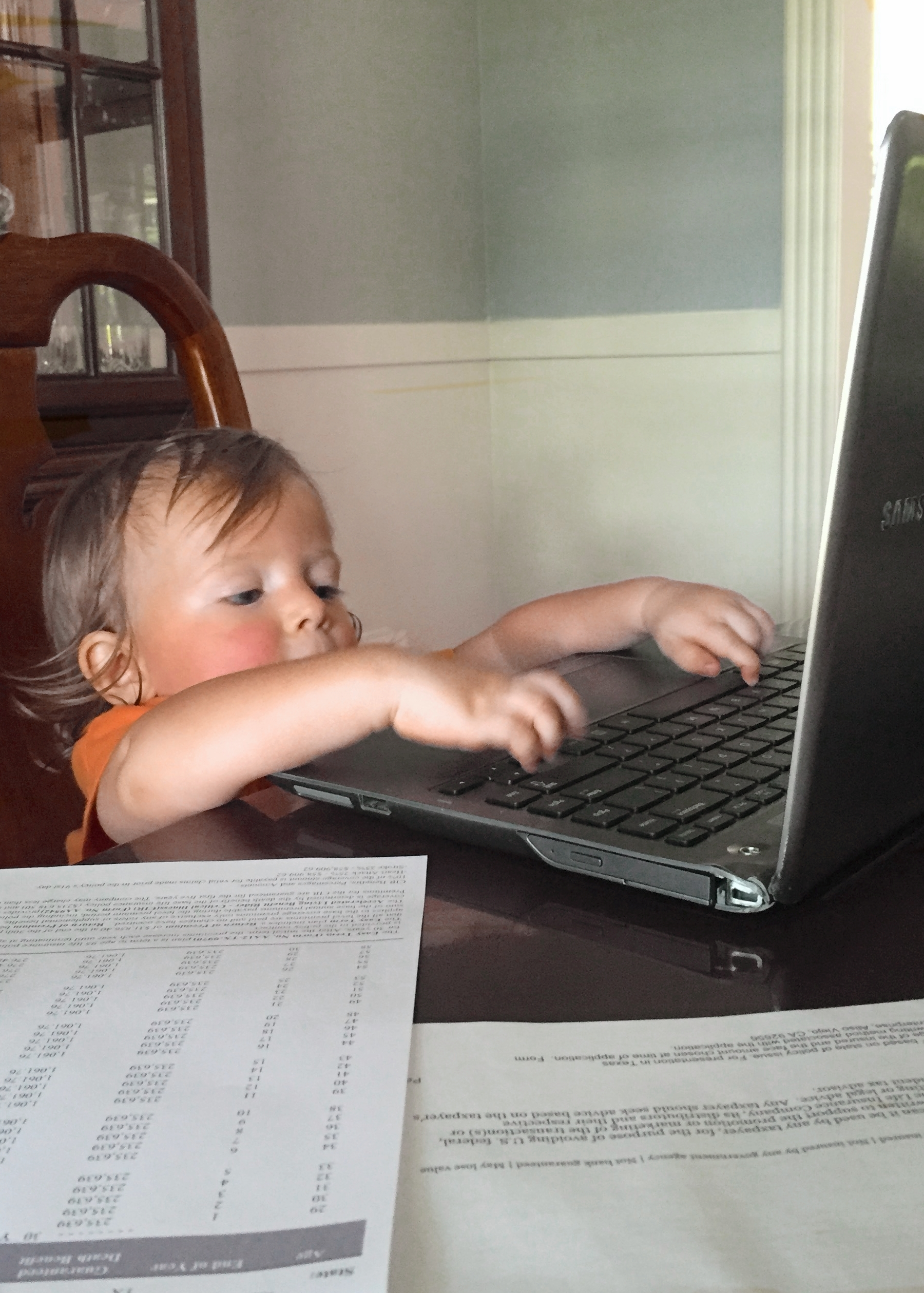 My tiny assistant editing our next novel.