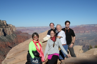 Ann Major posing with husband and grown children at Grand Canyon