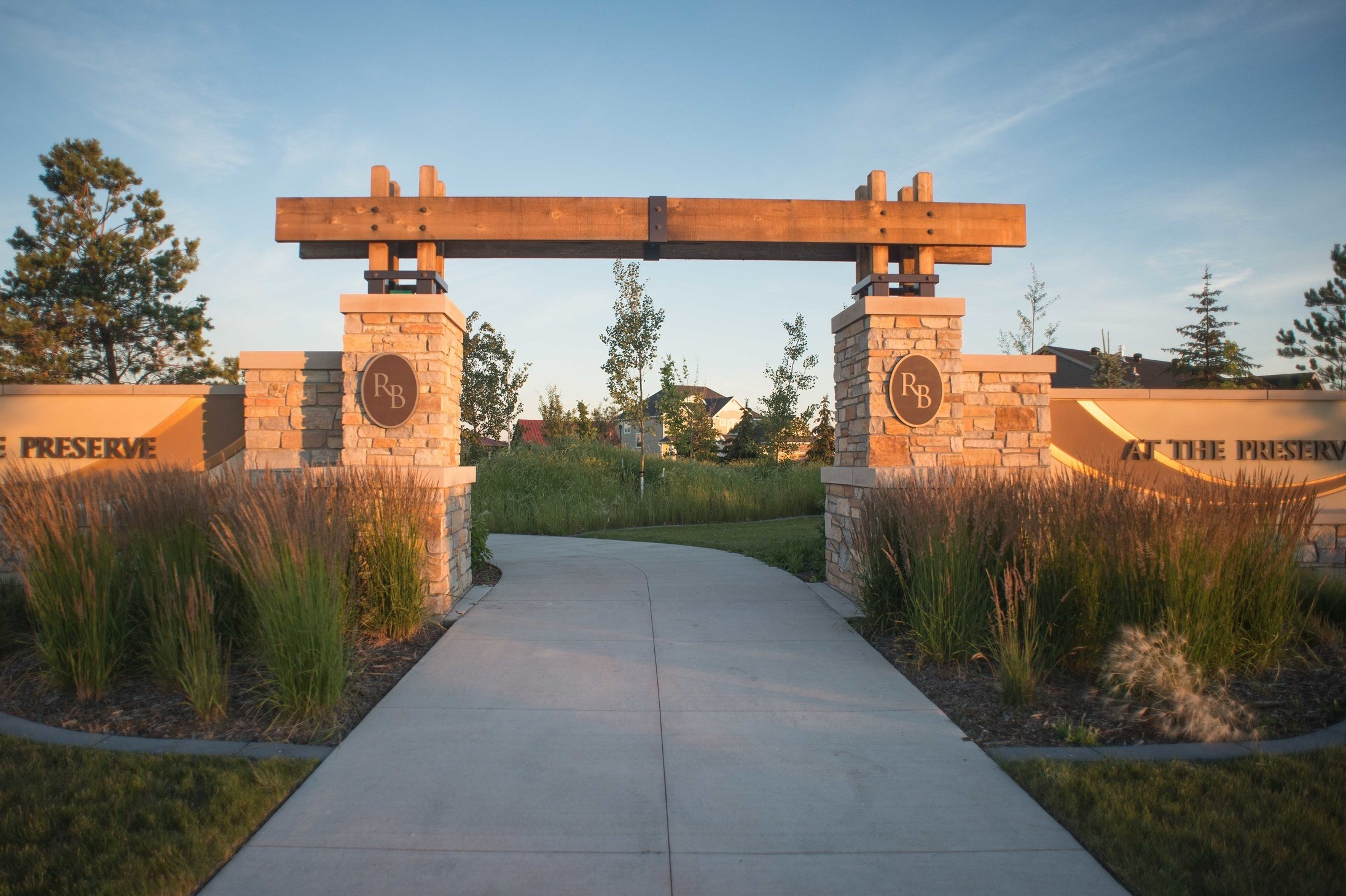 The project goal was to preserve the integrity of the site's stand of riparian forest while creating a one of a kind setting for an upscale housing project.