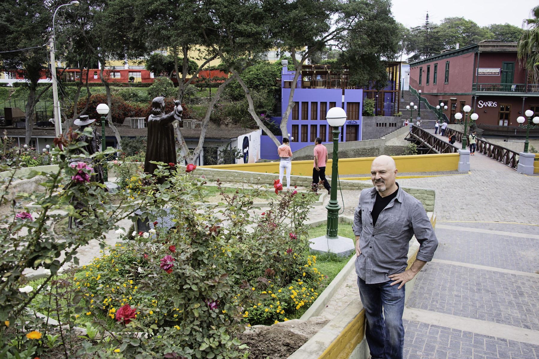 Fabio Posing Next to Flowers in Barranco Lima