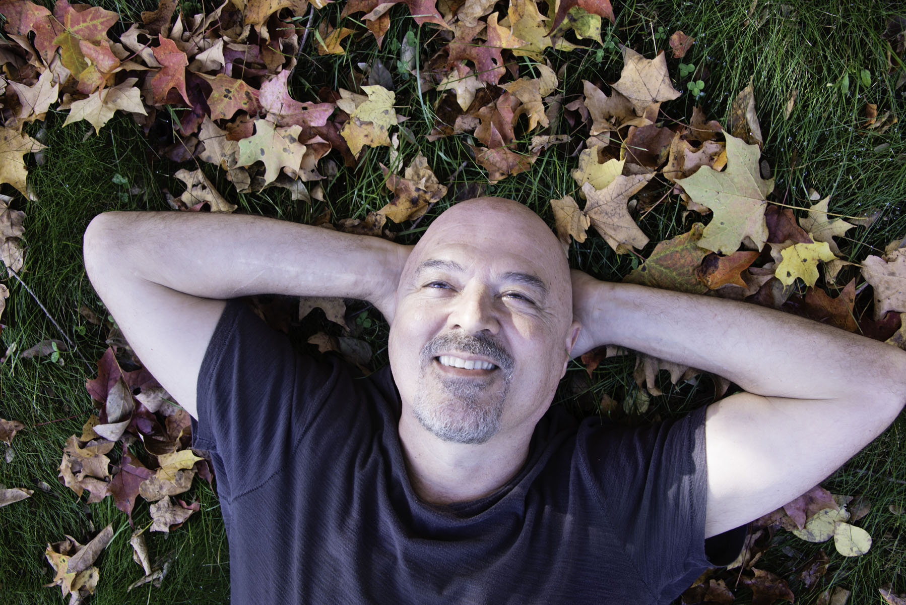 Man Laying in Leaves