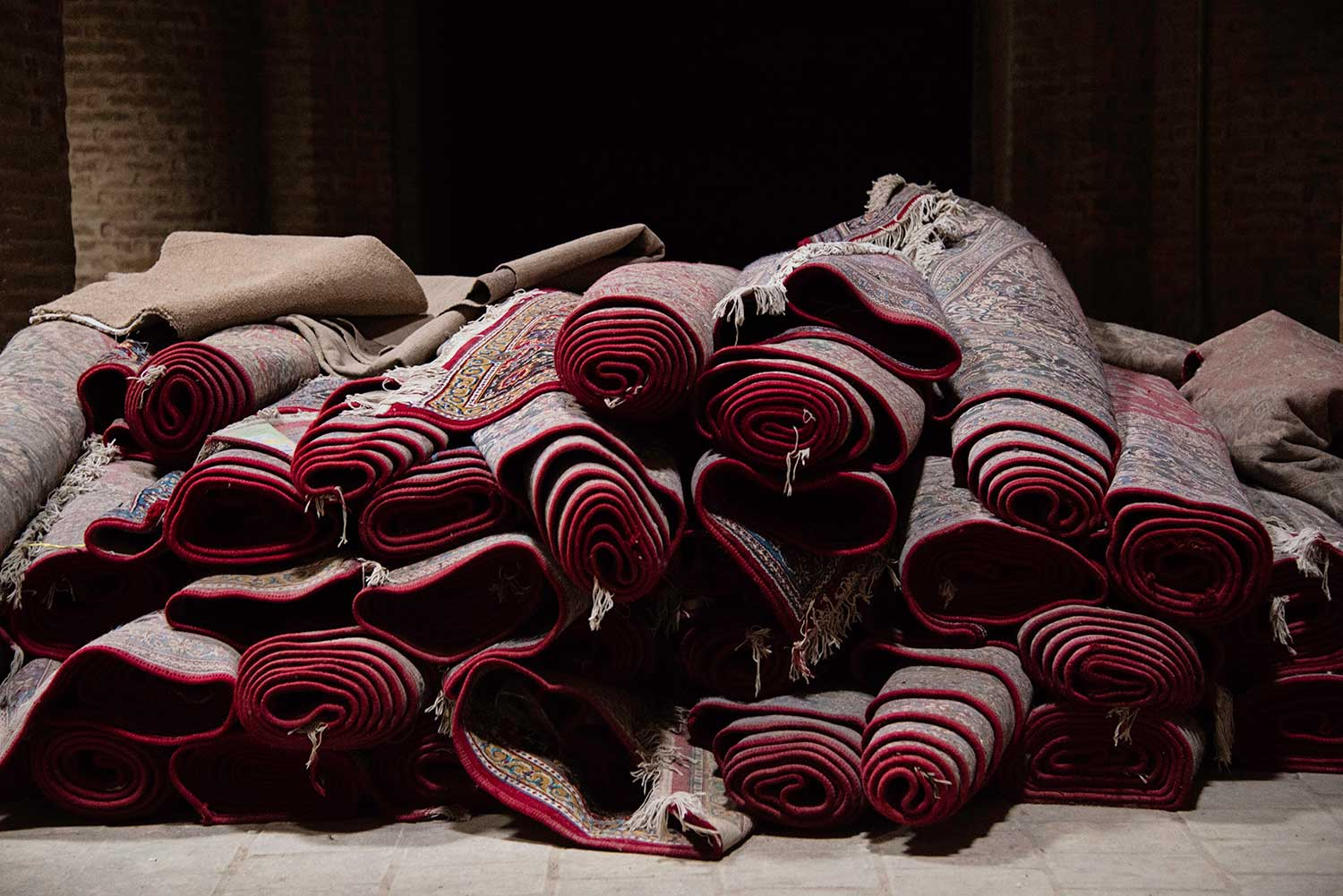 Pile of Rolled Rugs