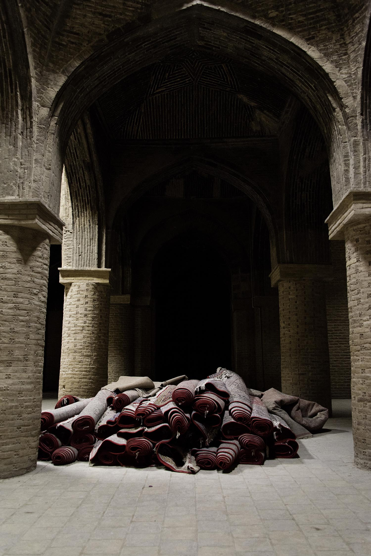 Pile of Rolled Prayer Rugs