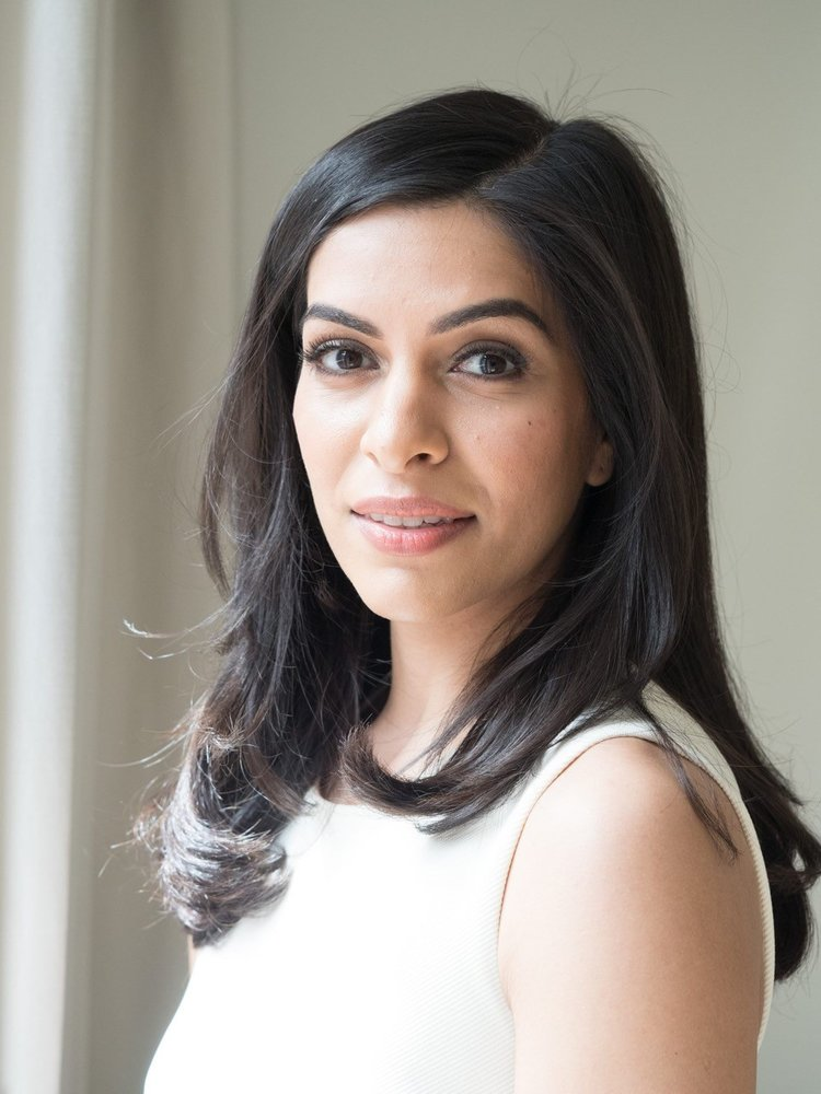 Nadira Lalji - Nadira is a hotelier. In 2017, she combined her interests in wellbeing and sustainability in Inhabit Hotels, a wellness brand focused on restoring and inspiring healthy habits at an accessible price (amongst other things!). The first hotel opens this summer in London, with a second site underway.In addition, Nadira helps oversee her family's London portfolio, twenty hotels under the Montcalm and Park Grand brands. Prior to joining her family business, Nadira worked for Four Seasons Hotels & Resorts in Toronto and Monitor Group in London and New York. Nadira graduated summa cum laude from Harvard University in 2009 and was a John Eliot Scholar at Cambridge University in 2010. She received her MBA from Harvard Business School in 2015. Nadira's philanthropic interests include microfinance and education in East Africa. She enjoys yoga and is a karate black belt.