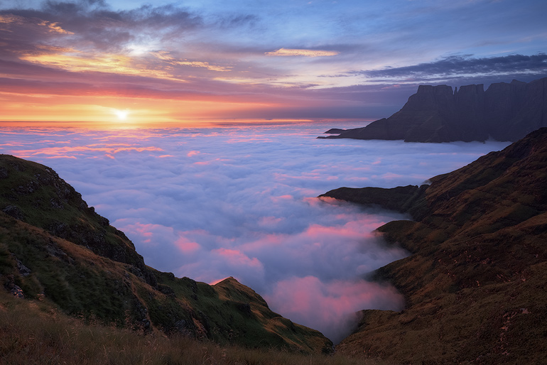 A beautiful cloud inversion covers the world below as the first rays of sunlight catch the peaks of the clouds below with an intense pink light. This was the start of a magnificent 3-day adventure into the Drakensberg mountains.