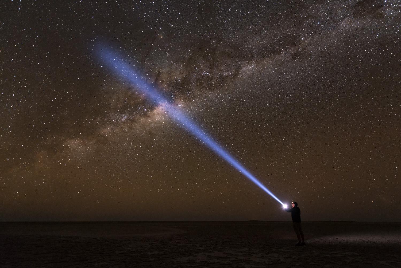 Night sky Milky Way torch person light beam Makgadikgadi Salt Pans Botswana Kubu Island Landscape Nocturnal night photo