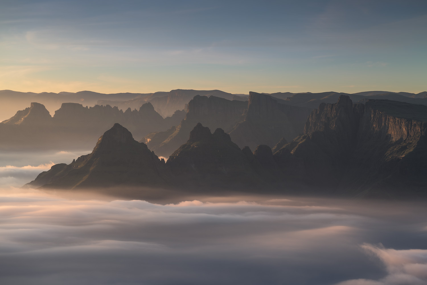 Nikon D850 / 70-200 f4 lens @ 145mm / ISO 64 - f/8 - 1/30 sec. The morning continued to produce amazing conditions and after the sun had risen, I captured this image as the first rays of light hit the inversion below.
