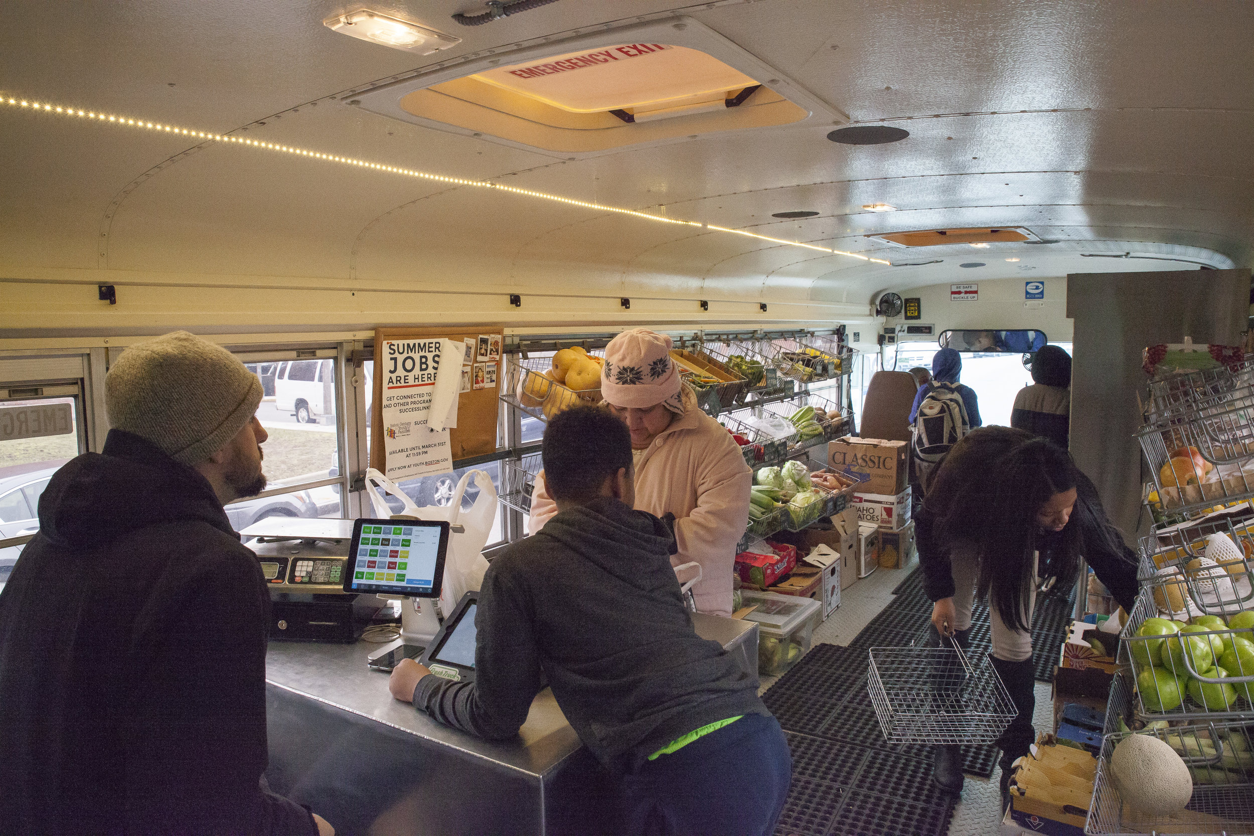 Dorchester Residents shop for groceries abroad Fresh Truck every wednesday near Harambee Park.