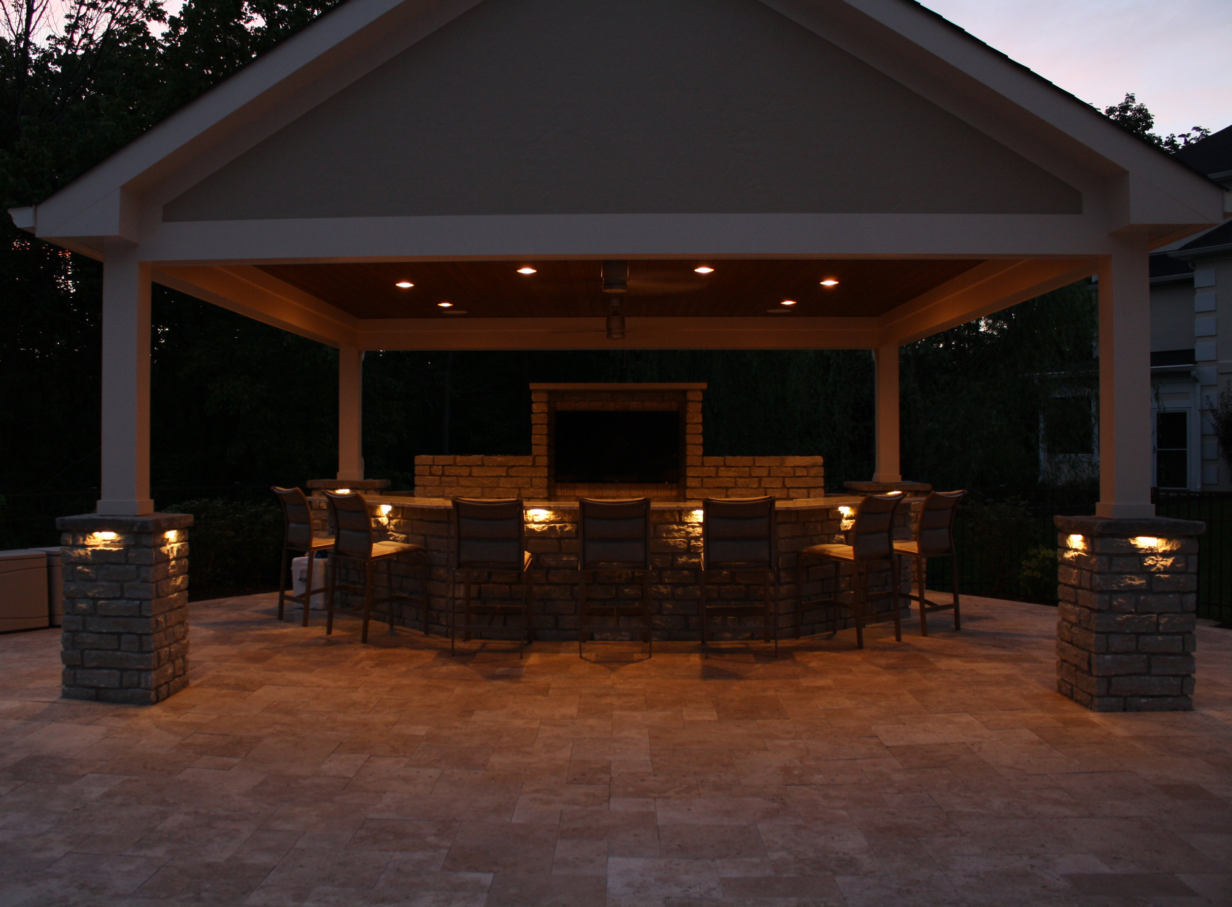 Accent lighting for stone columns outdoors.