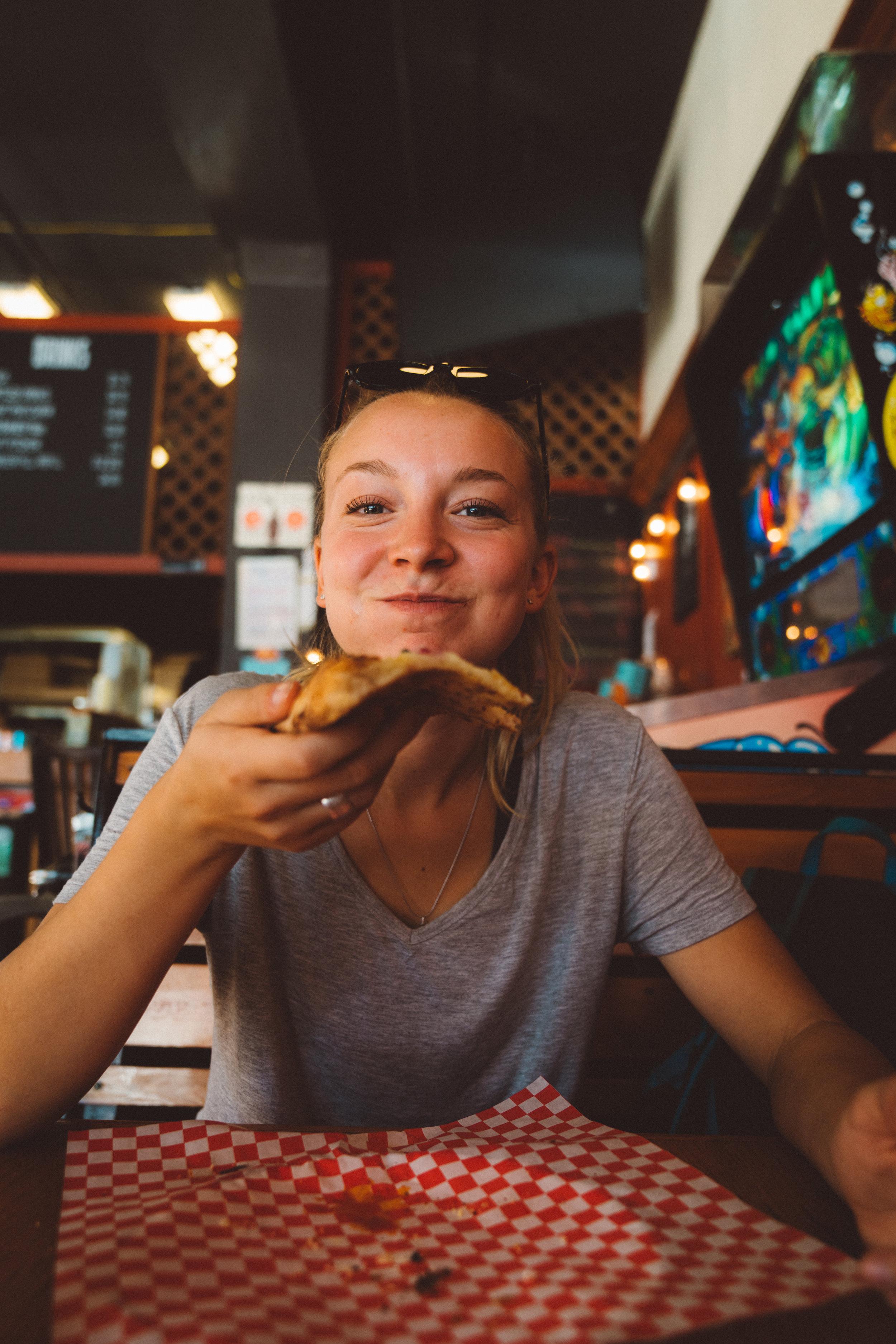 Danielle enjoying Straight from NY pizza.