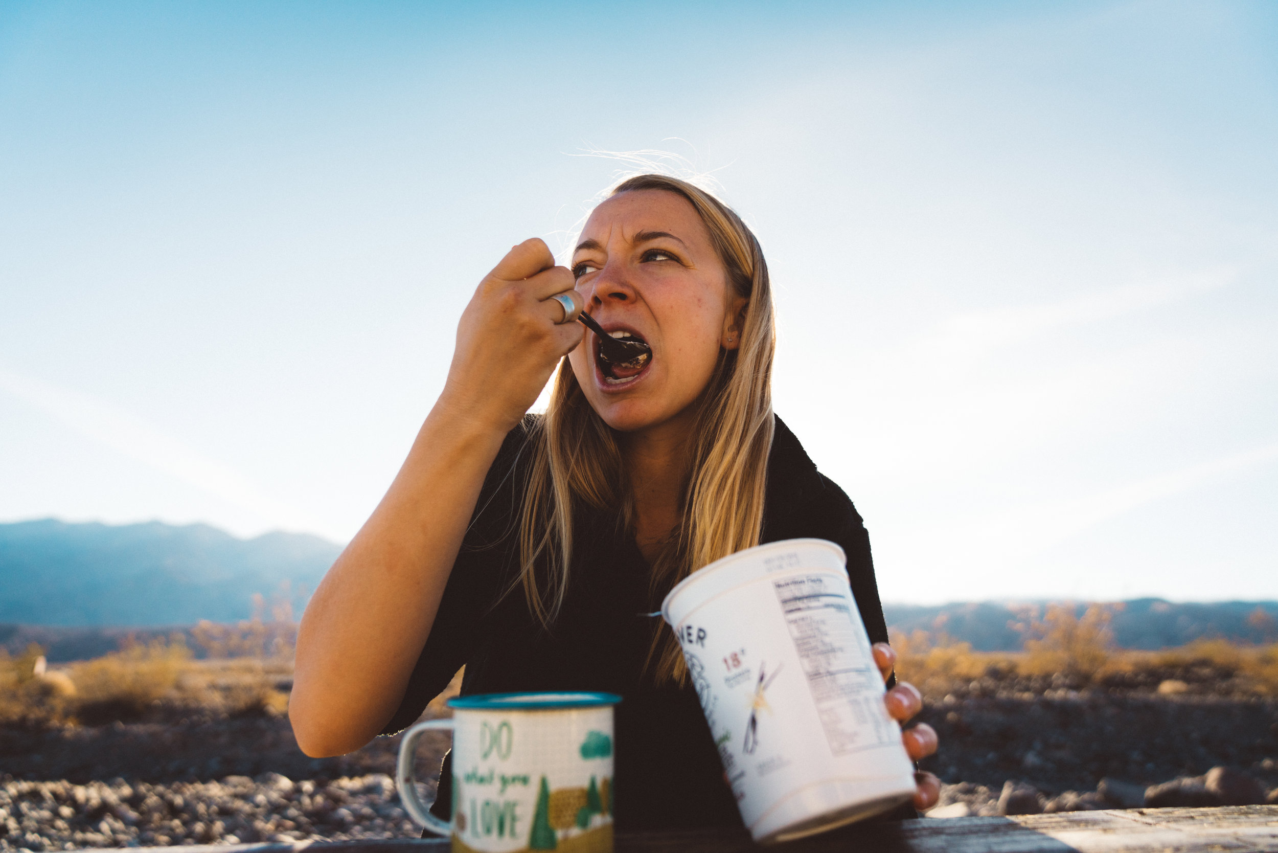Danielle enjoying granola and yogurt for breakfast at Emigrant Campground.