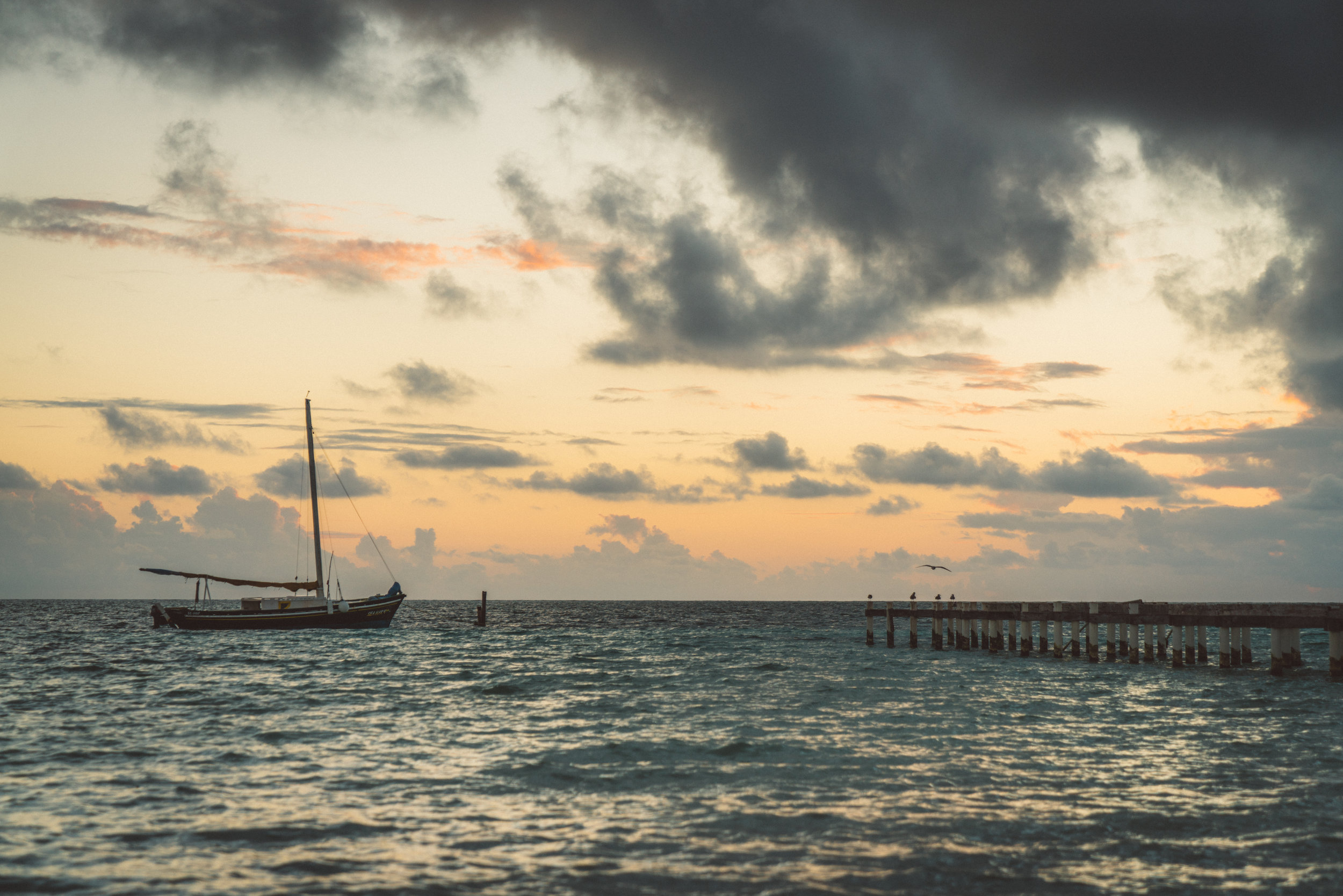 One of the many docks on Caye Caulker seen at sunrise.