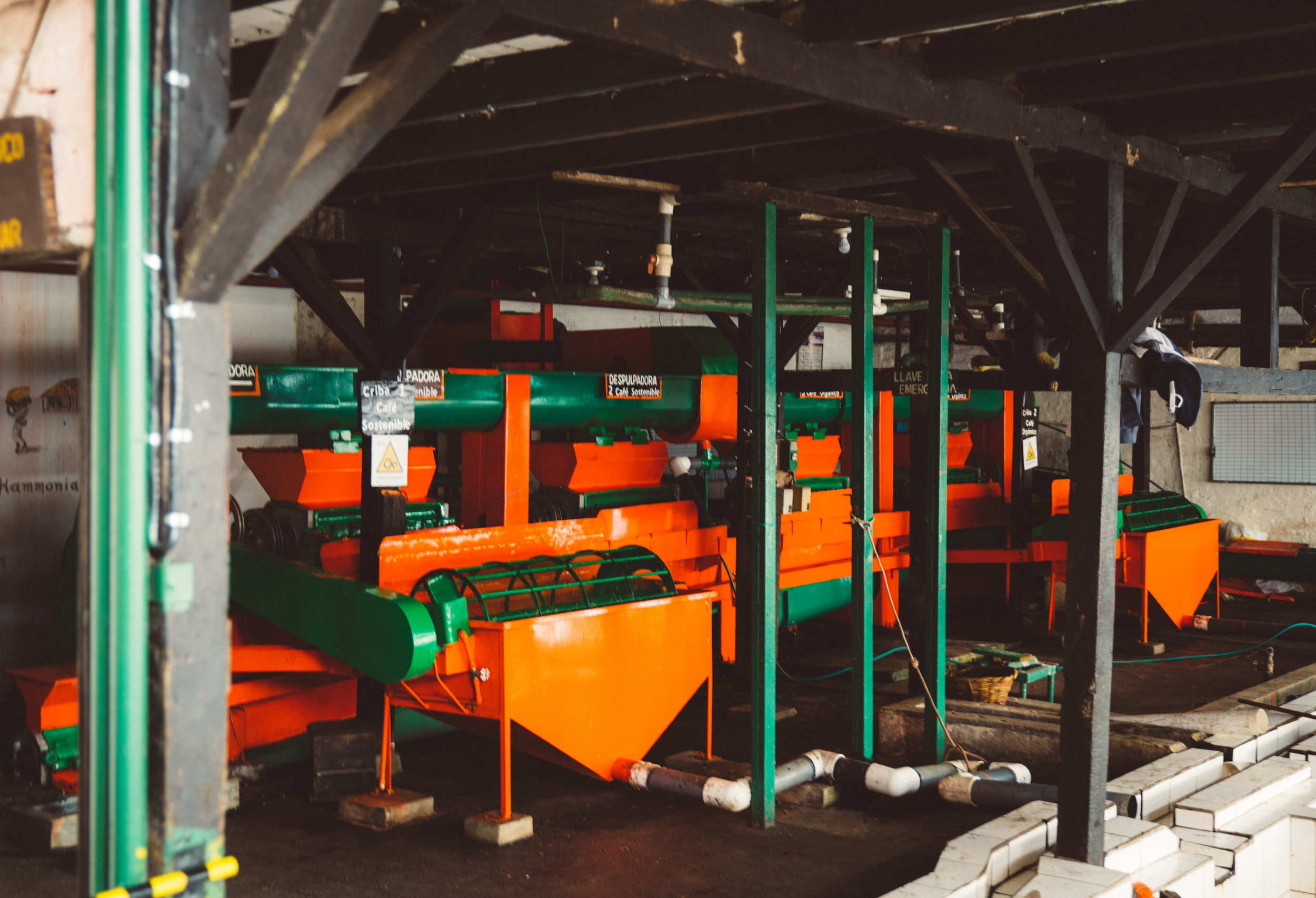 From the sorting tank pictured above, the berries flow down a tube into this expensive and shiny de-shelling machine.