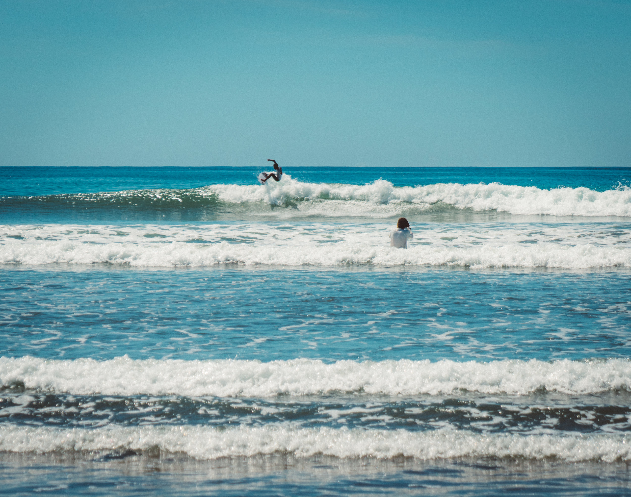 Some professional surfers competing in Dominical.