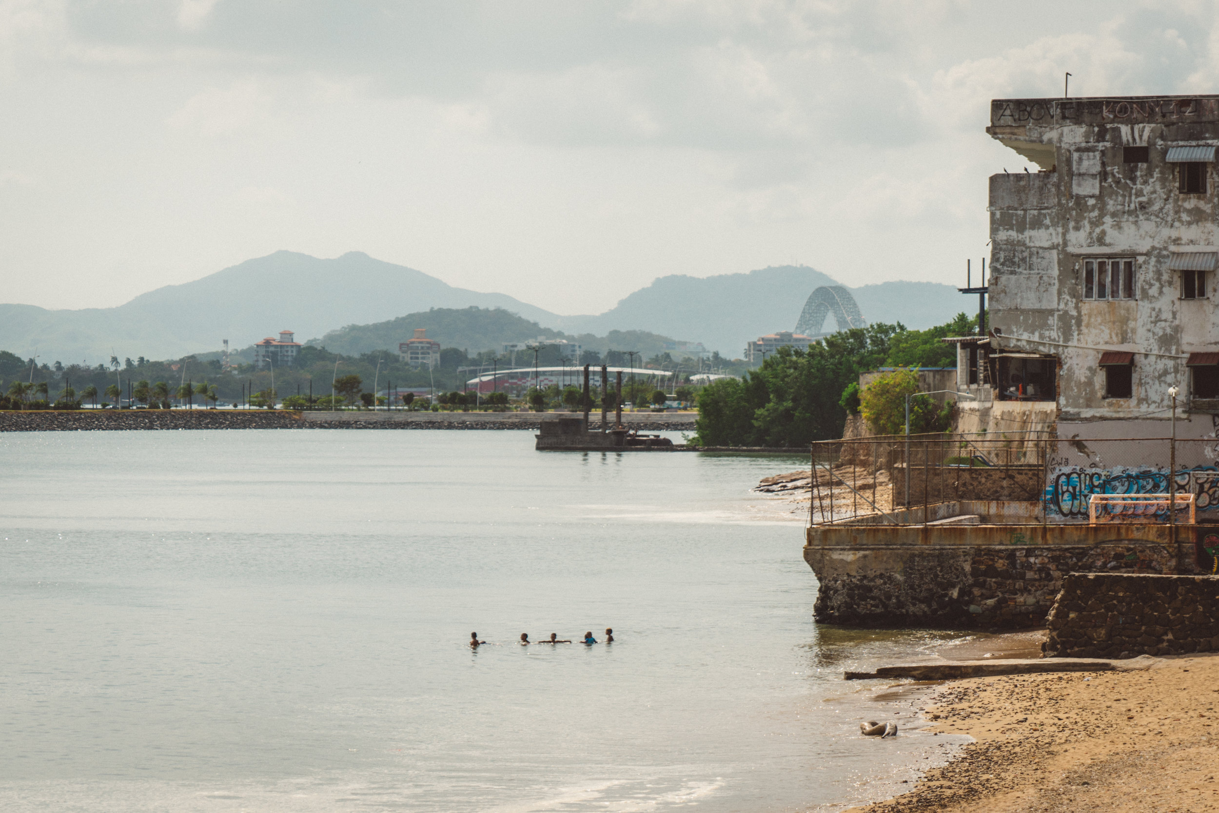 Some kids swimming off Casco Viejo. The Bridge of the Americas, which spans the Canal, is visible in the background.