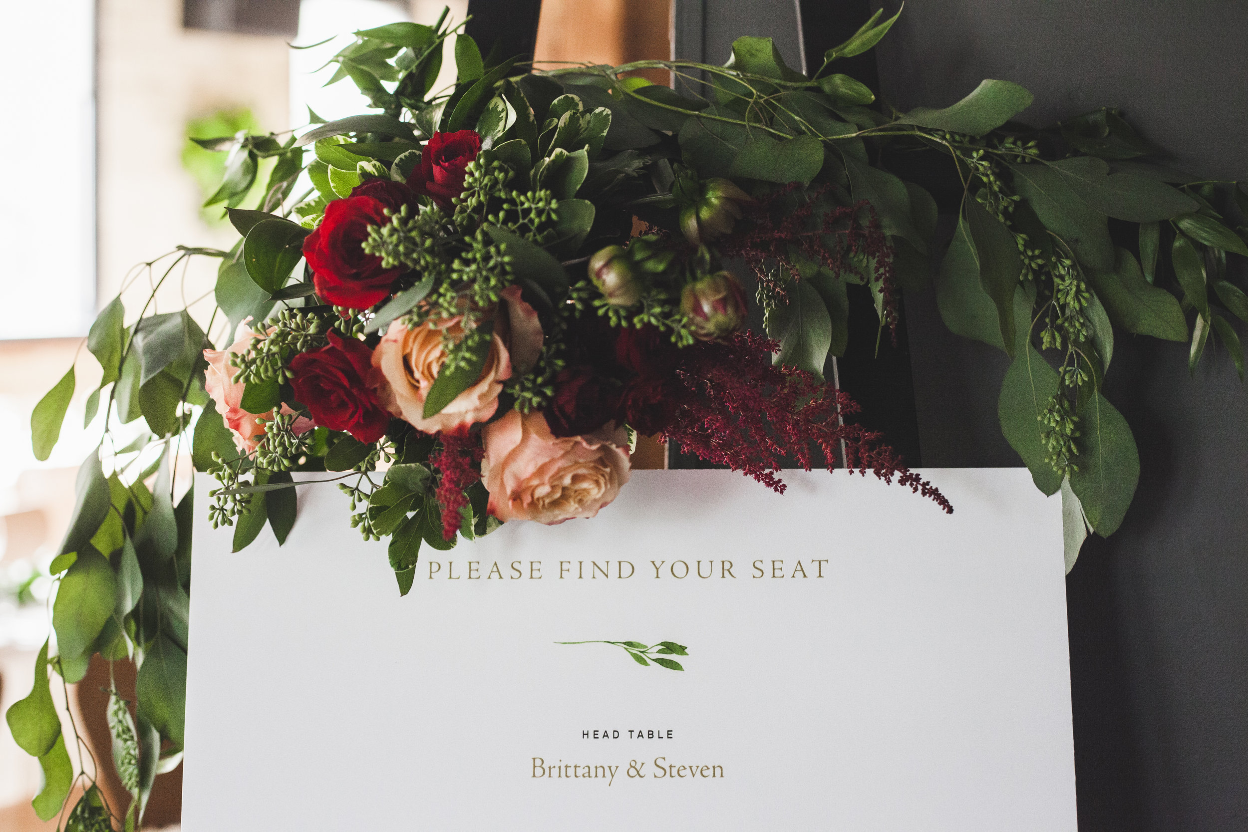 Brittany + Steven | Welcome easel florals | Photo: Shlomi Amiga Weddings