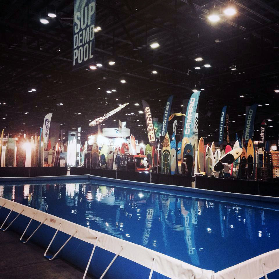 Step Up Productions pool used for stand up paddleboarding at a surf expo.