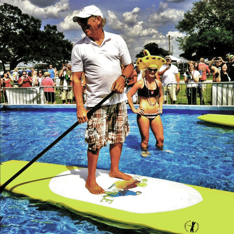 Jimmy Buffett paddleboarding at a Step Up Productions SUP event.