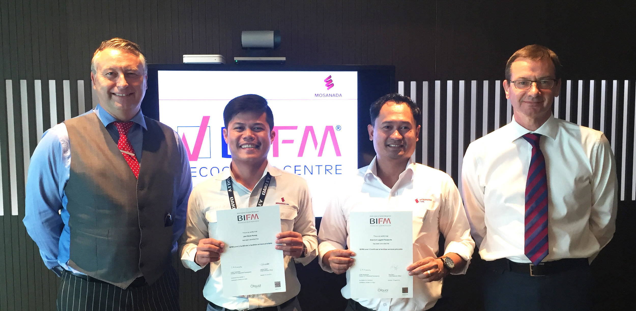 From Left: Julian Burton, BIFM assessor with BIFM Graduates Joel Nunag, and Edanrich Pasaporte, and Martin Campbell Director of Business Solutions.