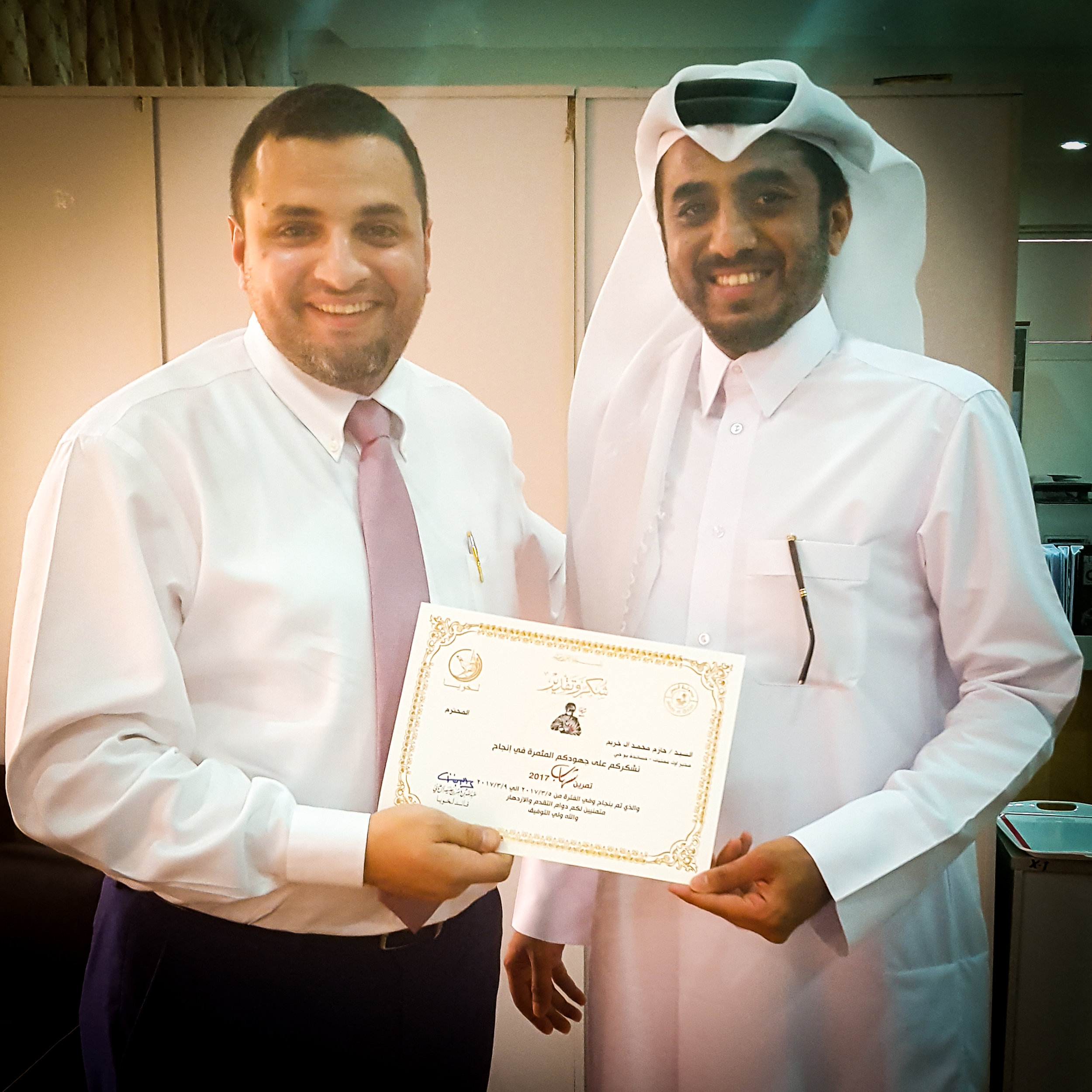 Hazem Khraim (Senior Manager - Operations) receives his certificate from 2nd Lieutenant, Khalid Ali Al-Buainain (Lekhwiya Officer)