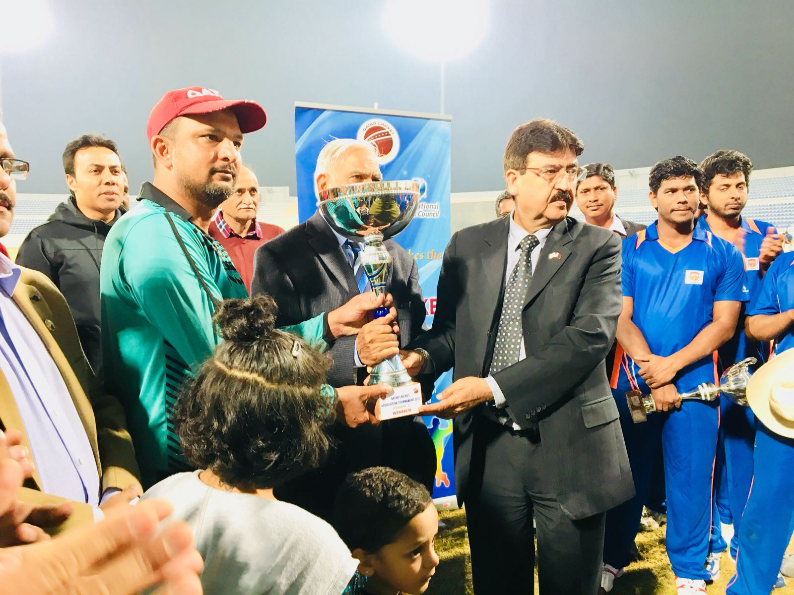 Champion trophy presented by Qatar Cricket Association domestic head to Division C winners Mosanda Cricket Club, captained by Ahmer Khan.