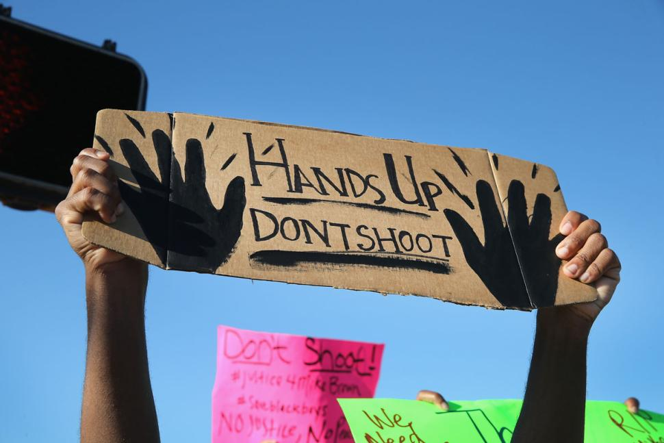 A photograph from a 2014 rally after the death of Michael Brown in Ferguson, MO