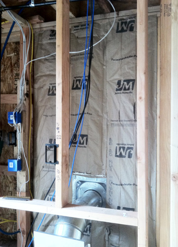 Step 2: Insulate with Formaldehyde Free Fiberglass Insulation. Staple craft paper facing tight to stud edges.