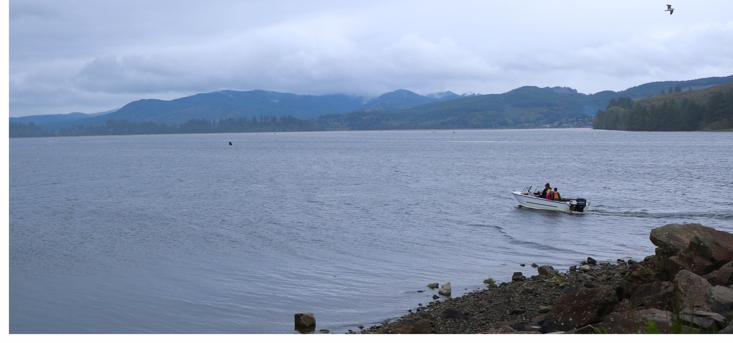 Lone crabbing boat heads out into Nehalem Bay, Oregon.