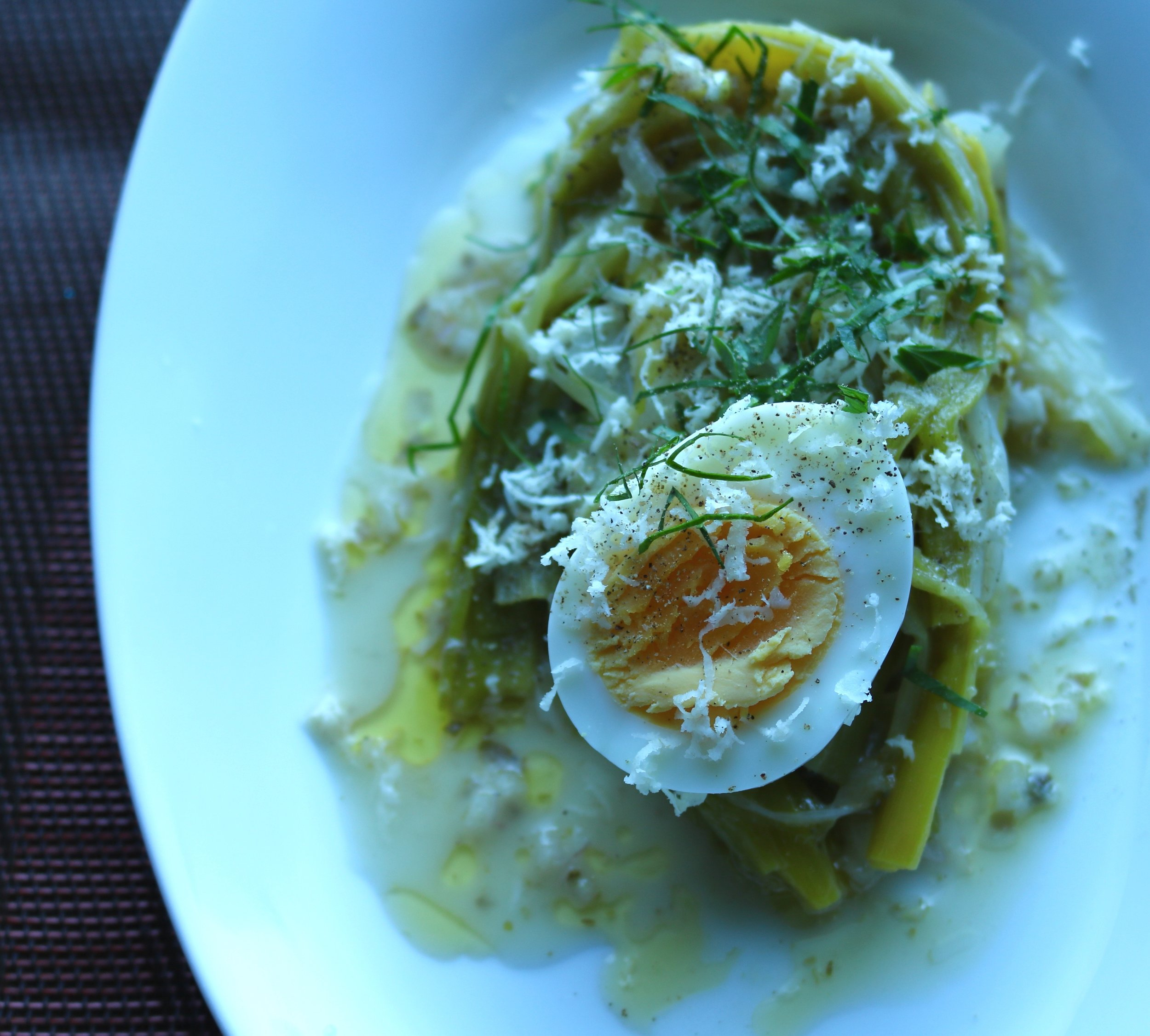 Braised Leeks with soft cooked egg and horseradish