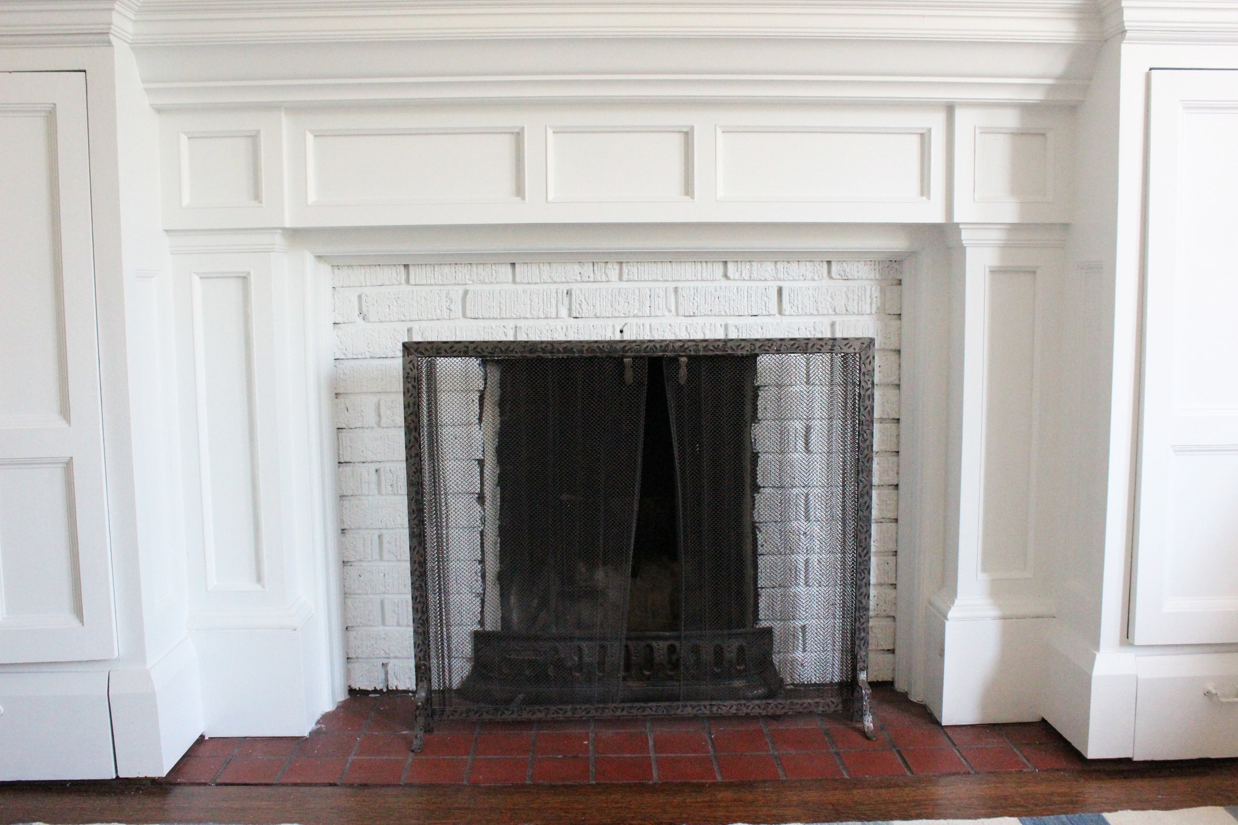 Our healthy brick fireplace post paint, lovely fresh, clean pop!