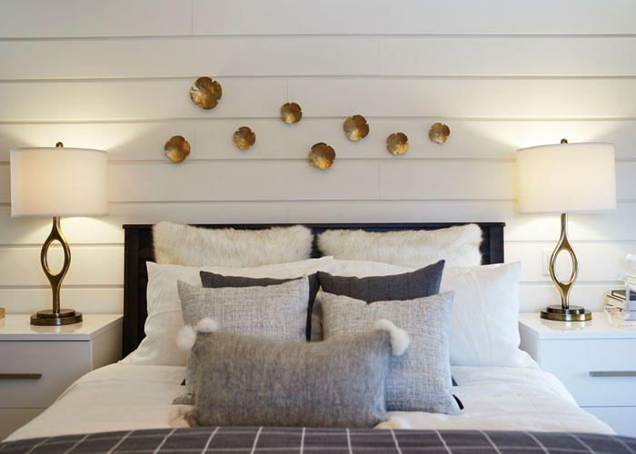 This master bedroom retreat has everything you could dream of: cozy warm whites, a cohesive modern and classic mix, and layers of pillows on the perfect Tempurpedic mattress.