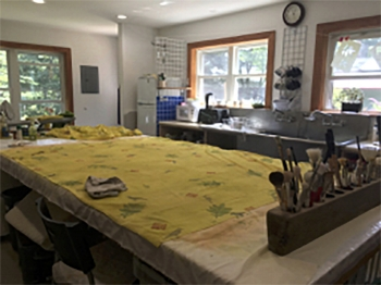 One curtain panel on my painting table in the studio.