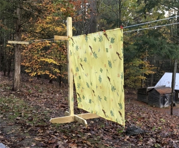 One panel hanging on the studio clothes line.