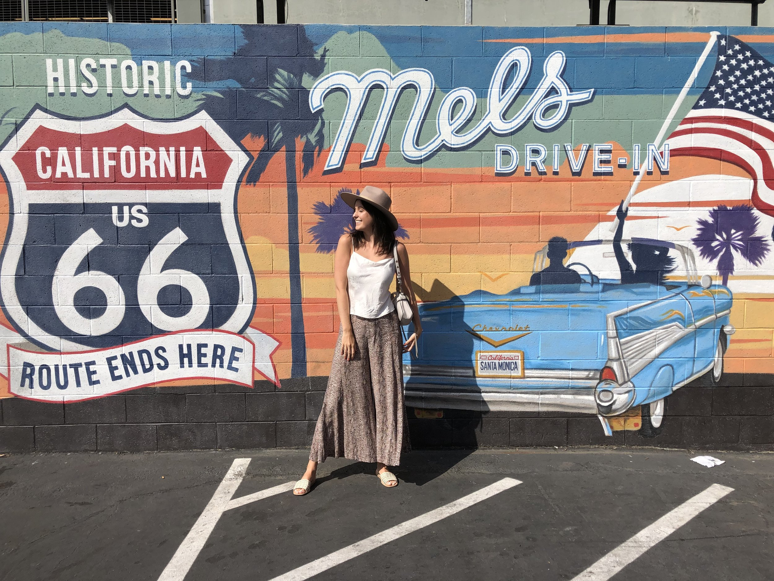 Photo Op outside Mel's in Santa Monica. Pants:  Anthropologie . Top:  Alice + Olivia . Hat:  Lack of Color .
